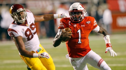 <p>               Utah quarterback Tyler Huntley (1) carries the ball in for a touchdown as Southern California defensive lineman Christian Rector (89) pursues during the first half of an NCAA college football game Saturday, Oct. 20, 2018, in Salt Lake City. (AP Photo/Rick Bowmer)             </p>