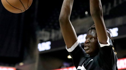 <p>               FILE - In this April 8, 2018, file photo, Black Team's Bol Bol dunks against the White Team during the Jordan Brand Classic high school basketball game, in New York. At least at the start of Oregon's season, all eyes will be on Bol Bol. The 7-foot-3 son of the late Manute Bol, is the highest-ranked prospect ever signed by the Ducks .(AP Photo/Gregory Payan, File)             </p>