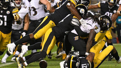 <p>               FILE - In this Sunday, Sept. 30, 2018, file photo, Baltimore Ravens running back Alex Collins (34) fumbles the football as he is gang tackled by the Pittsburgh Steelers defense during the first half of an NFL football game in Pittsburgh. The Steelers' Terrell Edmunds recovered the ball. The Steelers with the NFL's 30th ranked defense insist it's not time to panic. Yet if they can't get it together soon, like say on Sunday against Atlanta,  it might be time to start. (AP Photo/Don Wright, File)             </p>