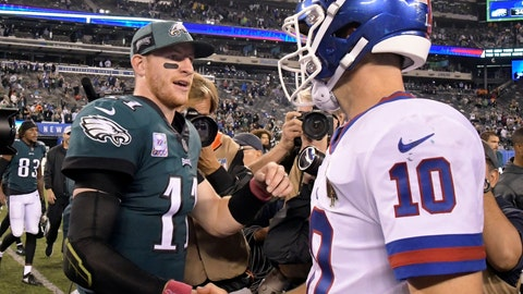<p>               Philadelphia Eagles quarterback Carson Wentz (11) shakes hands with New York Giants quarterback Eli Manning (10) after an NFL football game Thursday, Oct. 11, 2018, in East Rutherford, N.J. The Eagles won 34-13. (AP Photo/Bill Kostroun)             </p>