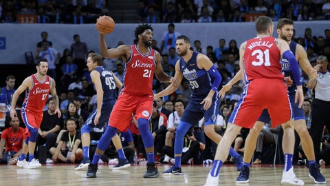 <p>               Joel Embiod of the Philadelphia 76ers, third left, controls the ball away from Salah Mejri of Dallas Mavericks, third right, during the Shenzhen basketball match between the Philadelphia 76ers and the Dallas Maverick, part of the NBA China Games, in Shenzhen city, south China's Guangdong province, Monday, Oct. 8, 2018. (AP Photo/Kin Cheung)             </p>