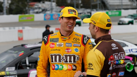 <p>               Kyle Busch, left, talks to a crew member after winning the pole position for Sunday's Monster Energy NASCAR Cup Series race at Martinsville Speedway in Martinsville, Va., Saturday, Oct. 27, 2018. (AP Photo/Steve Helber)             </p>