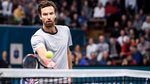 <p>               Ernests Gulbis of Latvia returns to John Isner of US, during their semi-final of the Stockholm Open tennis tournament at the Royal Tennis Hall in Stockholm, Sweden, Saturday Oct. 20, 2018. (Erik Simander / TT via AP)             </p>