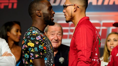 """<p>               Boxers Jose Benavidez Jr., right, of Phoenix,, and Terence """"Bud"""" Crawford, of Omaha, face each other during a news conference in Omaha, Neb., Thursday, Oct. 11, 2018, ahead of their welterweight WBO world title bout on Saturday. There has been friction between Benavidez and Crawford since February, when Benavidez accused Crawford, the champ, of ducking him. (AP Photo/Nati Harnik)             </p>"""