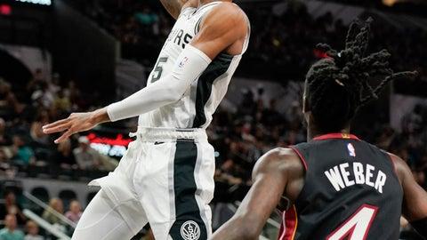 <p>               San Antonio Spurs' Dejounte Murray, left, shoots as Miami Heat's Briante Weber looks on during the second half of an NBA preseason basketball game, Sunday, Sept. 30, 2018, in San Antonio. San Antonio won 104-100. (AP Photo/Darren Abate)             </p>