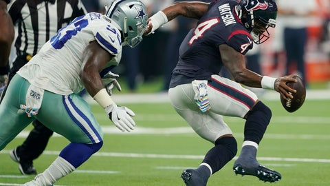 <p>               Houston Texans quarterback Deshaun Watson (4) is pressured by Dallas Cowboys defensive tackle Daniel Ross (93) during the first half of an NFL football game, Sunday, Oct. 7, 2018, in Houston. (AP Photo/David J. Phillip)             </p>