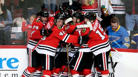 <p>               Chicago Blackhawks right wing Alex DeBrincat, center, celebrates with teammates after scoring in overtime against the St. Louis Blues during an NHL hockey game Saturday, Oct. 13, 2018, in Chicago. The Blackhawks won 4-3. (AP Photo/Nam Y. Huh)             </p>