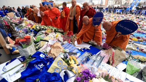 <p>               Buddhist Monks pay their respects at Leicester City soccer club Tuesday Oct. 30, 2018, after Leicester Chairman Vichai Srivaddhanaprabha, seen in poster, died along with four other people Saturday evening in a helicopter crash outside King Power Stadium. The flight data recorder from the helicopter that crashed with the Leicester soccer team's owner on board is being examined by investigators, authorities said. (Mike Egerton/PA via AP)             </p>