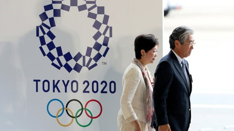 <p>               FIEL - In this Aug. 24, 201, file photo, Tokyo Gov. Yuriko Koike, second from right, and Tsunekazu Takeda, president of the Japanese Olympic Committee, walk past the logo of the Tokyo 2020 Olympics during the Olympic flag arrival ceremony at Haneda international airport in Tokyo. The price tag keeps soaring for the 2020 Tokyo Olympics despite local organizers and the International Olympic Committee saying that spending is being cut. (AP Photo/Eugene Hoshiko, File)             </p>