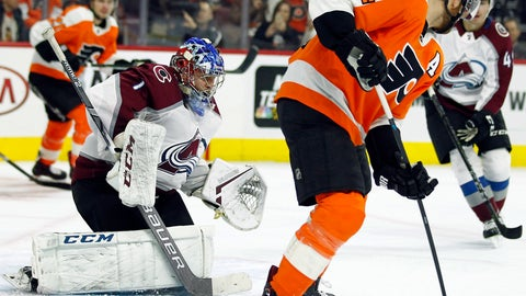 <p>               Colorado Avalanche goalie Semyon Varlamov, left, defends the goal as Philadelphia Flyers' Sean Couturier tries to control the puck Wayne Simmonds during the second period of an NHL hockey game, Monday, Oct. 22, 2018, in Philadelphia. (AP Photo/Tom Mihalek)             </p>