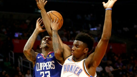 <p>               Los Angeles Clippers' Lou Williams (23) gets fouled by Oklahoma City Thunder's Hamidou Diallo (6) during the first half of an NBA basketball game Friday, Oct. 19, 2018, in Los Angeles. (AP Photo/Ringo H.W. Chiu)             </p>