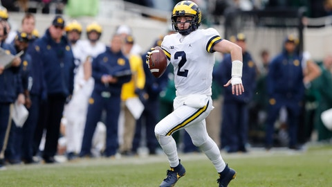 <p>               Michigan quarterback Shea Patterson scrambles during the first half of an NCAA college football game against Michigan State, Saturday, Oct. 20, 2018, in East Lansing, Mich. (AP Photo/Carlos Osorio)             </p>