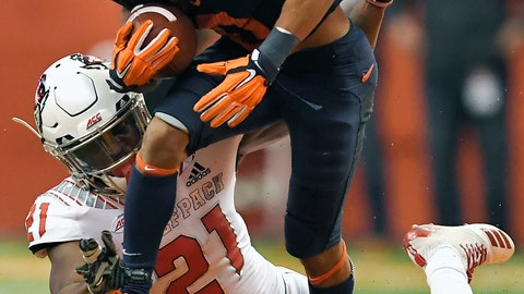 <p>               Syracuse wide receiver Sean Riley, top, tries to break the grasp of North Carolina State defensive back Stephen Griffin after a reception during the second half of an NCAA college football game in Syracuse, N.Y., Saturday, Oct. 27, 2018. (AP Photo/Adrian Kraus)             </p>