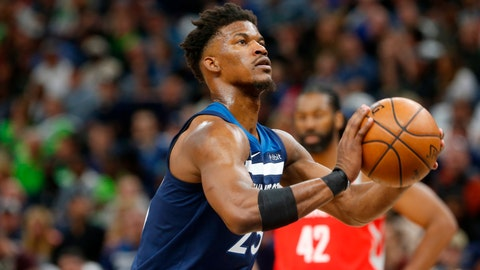 <p>               FILE - In this April 21, 2018, file photo, Minnesota Timberwolves' Jimmy Butler plays against the Houston Rockets in the first half during Game 3 of an NBA basketball first round playoff series in Minneapolis. With Butler's trade demand swirling like a dark cloud around coach Tom Thibodeau, newly minted super-max player Karl-Anthony Towns and the Timberwolves arrive for training camp. (AP Photo/Jim Mone, File)             </p>