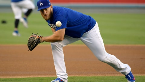 <p>               Los Angeles Dodgers' Max Muncy fields a ball during practice for Game 1 of the baseball team's NLCS against the Milwaukee Brewers, Wednesday, Oct. 10, 2018, in Los Angeles. With all the high-priced talent on the Dodgers' roster, Muncy had to find a way to stand out. He's done it with his bat, coming from the minors to lead the team in home runs. (AP Photo/Mark J. Terrill)             </p>