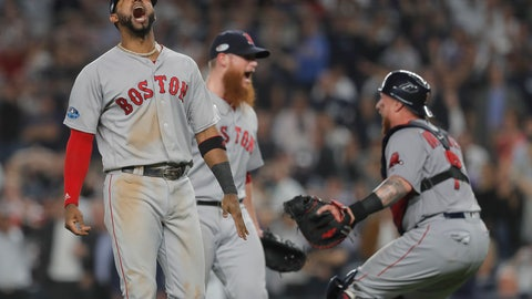 <p>               Boston Red Sox third baseman Eduardo Nunez, left, celebrates with relief pitcher Craig Kimbrel, center, and catcher Christian Vazquez after the Red Sox beat the New York Yankees 4-3 in Game 4 of baseball's American League Division Series, Tuesday, Oct. 9, 2018, in New York. (AP Photo/Julie Jacobson)             </p>