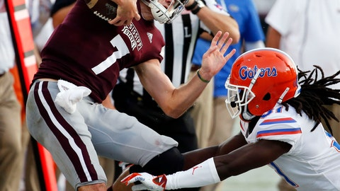 <p>               Mississippi State quarterback Nick Fitzgerald (7) is knocked out of bounds by a Florida defender during the first half of an NCAA college football game in Starkville, Miss., Saturday, Sept. 29, 2018. Florida won 13-6. (AP Photo/Rogelio V. Solis)             </p>
