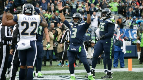 <p>               Seattle Seahawks quarterback Russell Wilson signals a touchdown after passing to wide receiver David Moore (not shown) early in the third quarter of an NFL football game against the Los Angeles Rams, Sunday, Oct. 7, 2018, in Seattle. (AP Photo/Scott Eklund)             </p>