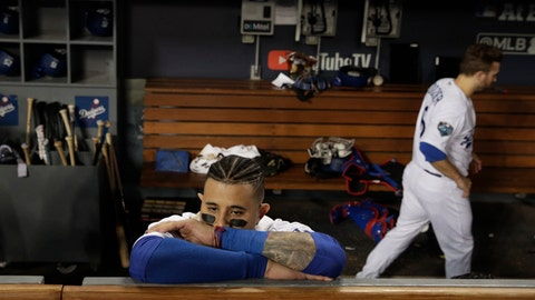 <p>               Los Angeles Dodgers' Manny Machado stands in the dugout after Game 5 of baseball's World Series against the Los Angeles Dodgers on Sunday, Oct. 28, 2018, in Los Angeles. The Red Sox won 5-1 to win the series 4 game to 1. (AP Photo/Jae C. Hong)             </p>