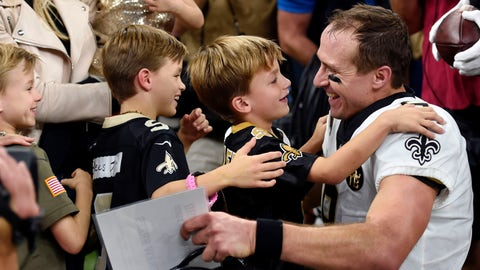 <p>               New Orleans Saints quarterback Drew Brees (9) greets his family after breaking the NFL all-time passing yards record in the first half of an NFL football game against the Washington Redskins in New Orleans, Monday, Oct. 8, 2018. (AP Photo/Bill Feig)             </p>