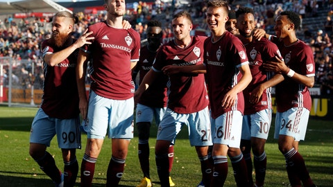 <p>               Colorado Rapids defender Tommy Smith, second from left, looks to the crowd after scoring the go-ahead goal as teammates, from left to right, midfielder Enzo Martinez, defender Deklan Wynne and midfielders Cole Bassett, Kellyn Acosta and Marlon Hairston come in to offer congratulations in the second half of an MLS soccer match against FC Dallas, Sunday, Oct. 28, 2018, in Commerce City, Colo. (AP Photo/David Zalubowski)             </p>