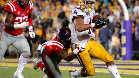 <p>               LSU running back Nick Brossette (4) carries against Mississippi linebacker Willie Hibbler and defensive end Tariqious Tisdale (22) during the second half of an NCAA college football game in Baton Rouge, La., Saturday, Sept. 29, 2018. LSU won 45-16. (AP Photo/Gerald Herbert)             </p>