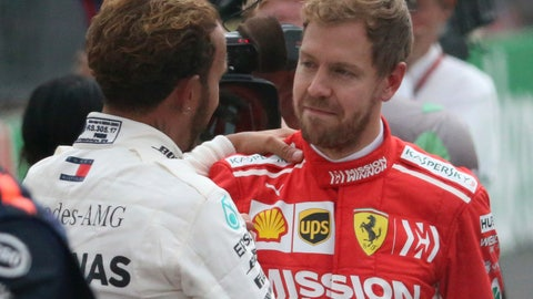 <p>               Mercedes driver Lewis Hamilton, of Britain, left, is congratulated by Ferrari driver Sebastian Vettel, of Germany, after Hamilton became Formula One champion in the Mexico Grand Prix auto race at the Hermanos Rodriguez racetrack in Mexico City, Sunday, Oct. 28, 2018. (AP Photo/Tomas Stargardter)             </p>