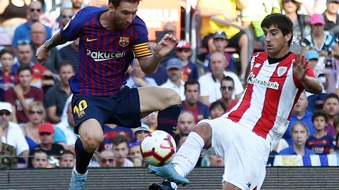 <p>               FC Barcelona's Lionel Messi, left, duels for the ball against Athletic Bilbao's Mikel San Jose during the Spanish La Liga soccer match between FC Barcelona and Athletic Bilbao at the Camp Nou stadium in Barcelona, Spain, Saturday, Sept. 29, 2018. (AP Photo/Manu Fernandez)             </p>