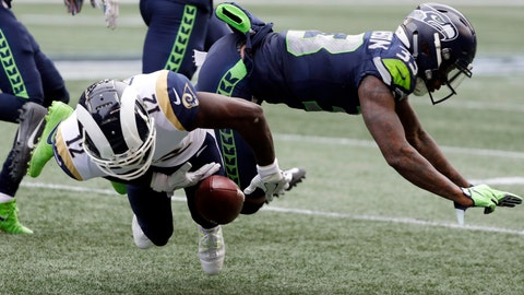 <p>               Los Angeles Rams wide receiver Brandin Cooks (12) is hit by Seattle Seahawks free safety Tedric Thompson, right, during the first half of an NFL football game, Sunday, Oct. 7, 2018, in Seattle. Cooks left the game with an injury after the play. (AP Photo/Elaine Thompson)             </p>