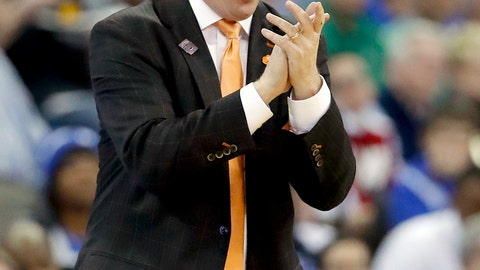 <p>               FILE - In this March 23, 2018, file photo, Clemson head coach Brad Brownell gestures on the sidelines during the first half of a regional semifinal game against Kansas in the NCAA men's college basketball tournament, in Omaha, Neb. Brownell enjoyed a school record 11 Atlantic Coast Conference wins, a run to the NCAA Tournament's Sweet 16 and new contract  extension tying him to the Tigers through 2024. Security is nice, but Brownell wants to keep producing success on the court.(AP Photo/Charlie Neibergall, File)             </p>