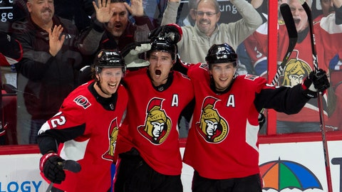 <p>               Ottawa Senators right wing Mark Stone celebrates his game-winning goal with teammates Thomas Chabot (72) and center Matt Duchene (95) during overtime of an NHL game in Ottawa, Ontario, Saturday, Oct. 20, 2018. The Senators won, 4-3, in overtime. (Adrian Wyld/The Canadian Press via AP)             </p>