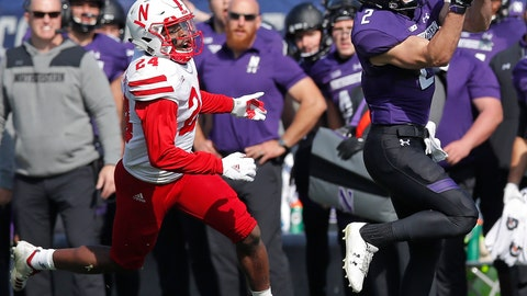 <p>               Northwestern's Flynn Nagel, right, makes a catch as Nebraska's Aaron Williams looks on during the second half of an NCAA college football game Saturday, Oct. 13, 2018, in Evanston, Ill.. (AP Photo/Jim Young)             </p>