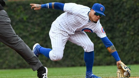 <p>               Chicago Cubs shortstop Javier Baez (9) fields a ball hit by Milwaukee Brewers' Lorenzo Cain (6) during the third inning of a tie break baseball game on Monday, Oct. 1, 2018, in Chicago. Baez threw to first for the out. (AP Photo/Matt Marton)             </p>
