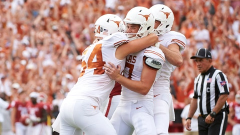 <p>               Texas kicker Cameron Dicker (17) celebrates with teammates after kicking the game-winning field goal in the closing seconds of the second half of an NCAA college football game against Oklahoma at the Cotton Bowl, Saturday, Oct. 6, 2018, in Dallas. Texas won 48-45. (AP Photo/Cooper Neill)             </p>