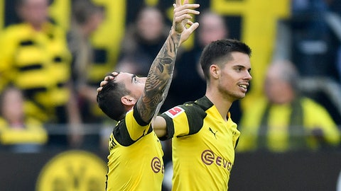 <p>               Dortmund's Paco Alcacer, left, celebrates with his teammate Julian Weigl, right, after scoring his side`s first goal  during the German Bundesliga soccer match between Borussia Dortmund and FC Augsburg in Dortmund, Germany, Saturday, Oct. 6, 2018. (AP Photo/Martin Meissner)             </p>