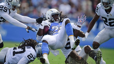 <p>               Los Angeles Chargers running back Melvin Gordon, center, is upended by Oakland Raiders free safety Reggie Nelson (27) and linebacker Marquel Lee, second from right, during the first half of an NFL football game Sunday, Oct. 7, 2018, in Carson, Calif. (AP Photo/Mark J. Terrill)             </p>