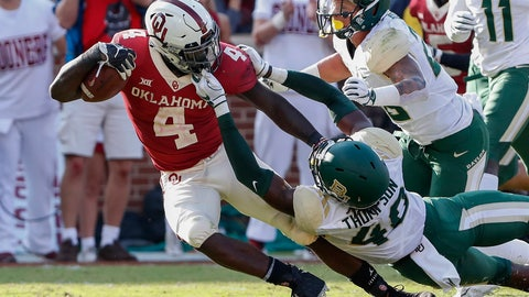 <p>               Baylor defensive end BJ Thompson (48) is called for face mask against Oklahoma running back Trey Sermon (4) in the second half of an NCAA college football game in Norman, Okla., Saturday, Sept. 29, 2018. Oklahoma won 66-33. (AP Photo/Alonzo Adams)             </p>