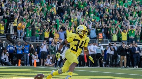 <p>               Oregon running back CJ Verdell (34), scores the winning touchdown in overtime to beat Washington 30-27 in an NCAA college football game in Eugene, Ore., Saturday, Oct. 13, 2018. (AP Photo/Thomas Boyd)             </p>