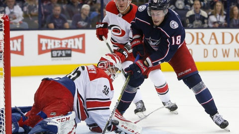 <p>               Carolina Hurricanes' Curtis McElhinney, left, makes a save against Columbus Blue Jackets' Pierre-Luc Dubois during the second period of an NHL hockey game Friday, Oct. 5, 2018, in Columbus, Ohio. (AP Photo/Jay LaPrete)             </p>