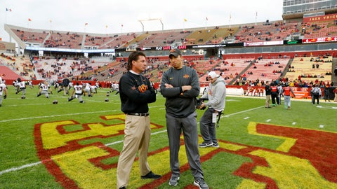 <p>               FILE - In this Nov. 11, 2017, file photo, Oklahoma State head coach Mike Gundy, left, talks with Iowa State head coach Matt Campbell before an NCAA college football game in Ames, Iowa. The two teams meet on Saturday. (AP Photo/Charlie Neibergall, File)             </p>