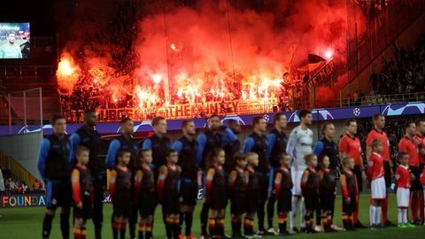 <p>               In this photo taken on Tuesday, Sept. 18, 2018 Dortmund fans set off flares as Club Brugge players stand on the pitch prior their Champions League group A soccer match with Dortmund at the Jan Breydel Stadium in Bruges. Belgian authorities charged five people Thursday in relation to a massive financial fraud and match-fixing probe into soccer. Financial fraud centered on two agents who had contacts with many of the leading clubs, including Anderlecht, Club Brugge and Standard Liege. (AP Photo/Francisco Seco)             </p>