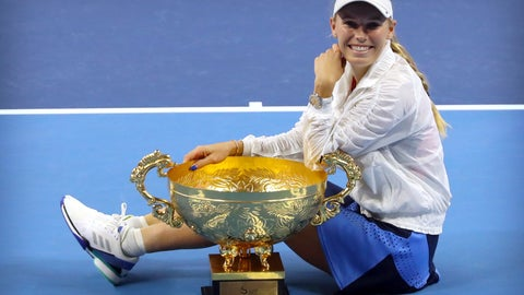 <p>               Caroline Wozniacki of Denmark poses with the winner's trophy after beating Anastasija Sevastova of Latvia in the women's singles final in the China Open at the National Tennis Center in Beijing, Sunday, Oct. 7, 2018. (AP Photo/Mark Schiefelbein)             </p>