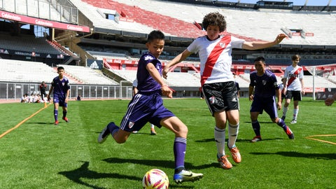 <p>               Young soccer Thai team Wild Boars play a friendly match against River Plate youth team at Monumental stadium in Buenos Aires, Argentina, Sunday, Oct. 7, 2018. The team made up of 12 boys and their coach, who were trapped in a flooded cave for almost three weeks in Thailand, are guests in Buenos Aires during the opening days of the Youth Olympic Summer Games. (Eitan Abramovich/Pool via AP)             </p>