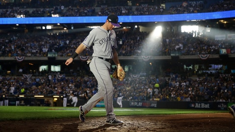 <p>               Colorado Rockies second baseman DJ LeMahieu walks off the field at the end of the fourth inning of Game 1 of the National League Divisional Series baseball game against the Milwaukee Brewers Thursday, Oct. 4, 2018, in Milwaukee. (AP Photo/Jeff Roberson)             </p>