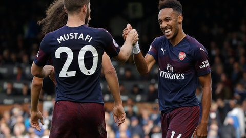 <p>               Arsenal's Pierre-Emerick Aubameyang, right, celebrates after he scored his side's fifth goal during the English Premier League soccer match between Fulham and Arsenal at Craven Cottage stadium in London, Sunday, Oct. 7, 2018. (AP Photo/Kirsty Wigglesworth)             </p>