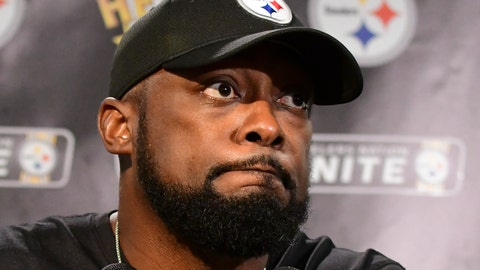 <p>               Pittsburgh Steelers head coach Mike Tomlin listens to a question while meeting with reporters following a 26-14 loss to the Baltimore Ravens in an NFL football game in Pittsburgh, Sunday, Sept. 30, 2018. (AP Photo/Fred Vuich)             </p>