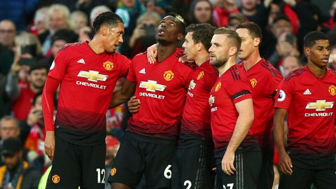 <p>               Manchester United's Paul Pogba, 2nd left, celebrates after scoring the opening goal during the English Premier League soccer match between Manchester United and Everton FC at Old Trafford in Manchester, England, Sunday Oct. 28, 2018. (AP Photo/Dave Thompson)             </p>