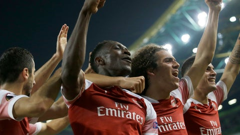 <p>               Teammates celebrate with Arsenal's Danny Welbeck, center left, who scored his side's first goal during the Europa League group E soccer match between Sporting CP and Arsenal at the Alvalade stadium in Lisbon, Thursday, Oct. 25, 2018. (AP Photo/Armando Franca)             </p>