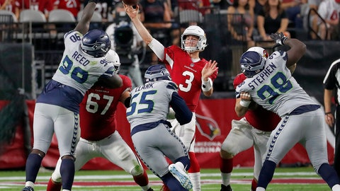 <p>               Arizona Cardinals quarterback Josh Rosen (3) throws over Seattle Seahawks defensive tackle Jarran Reed (90),offensive guard Germain Ifedi (65) and defensive tackle Shamar Stephen (98) during the second half of an NFL football game, Sunday, Sept. 30, 2018, in Glendale, Ariz. (AP Photo/Rick Scuteri)             </p>
