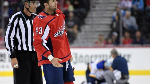 <p>               FILE - In this Sept. 30, 2018, file photo, Washington Capitals right wing Tom Wilson (43) is escorted by an official off the ice after he checked St. Louis Blues center Oskar Sundqvist, on ice at back center, during the second period of an NHL preseason hockey game, in Washington. Wilson has been suspended 20 games by the NHL for a blindside hit to the head of an opponent during a preseason game. Wilson's punishment was announced Wednesday, Oct. 3, 2018, just hours before the reigning Stanley Cup champion Capitals were to raise their banner and open their title defense by hosting the Boston Bruins to begin the regular season. (AP Photo/Nick Wass, File)             </p>